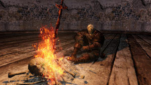 A dejected warrior waits by a bonfire