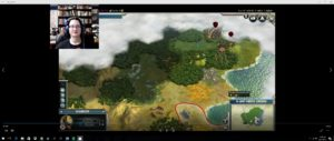 Screen capture of Civilization V. The placement of the facecam (top left) obscures some of the information (amount of gold, happiness level, etc.)