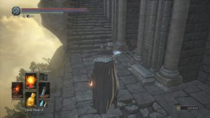 A screenshot from Dark Souls III showing the camera angle behind the player