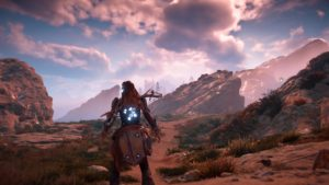 A screenshot of Horizon Zero Dawn showing the landscape and skybox.