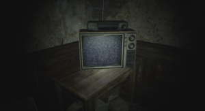 A television with a VCR on top sits on a table in the corner of a dark room. The television only displays static.
