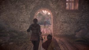 Image of Amicia holding her little brother Hugo's hand and leading them through the game level. Screenshot taken by author during gameplay.