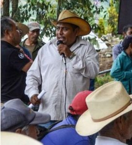 José Lucio Bartolo Faustino, a Nahua activist, pictured speaking to a crowd on a microphone. He was murdered in 2019 while involved in efforts to maintain indigenous sovereignty.